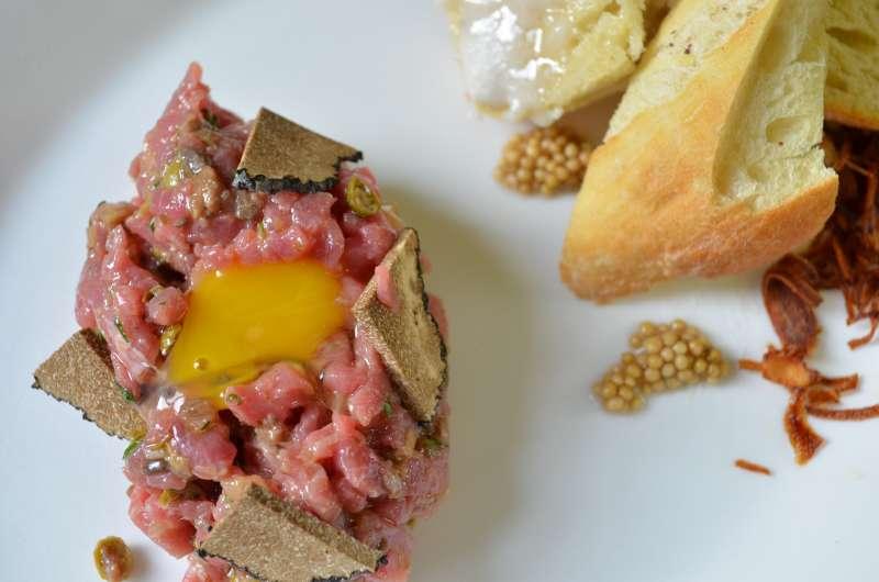 Le Québécois Veal Tartare, Burgundy Truffle, Quail Egg, Lardo, Pickled Mustard Seeds, Toast
