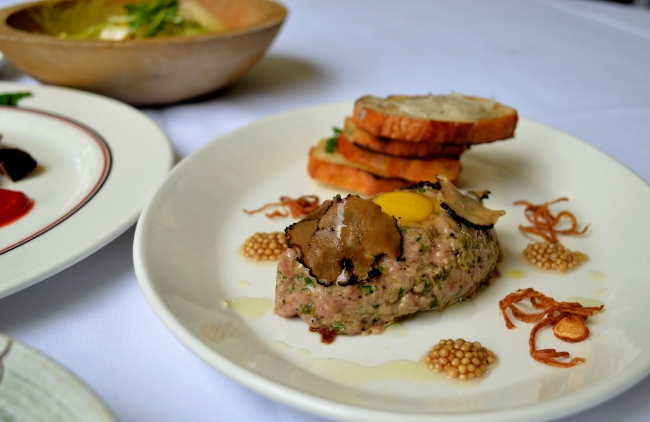 Le Québécois Veal Tartare: Burgundy Truffle, Quail Egg, Lardo, Pickled Mustard Seeds, Toast