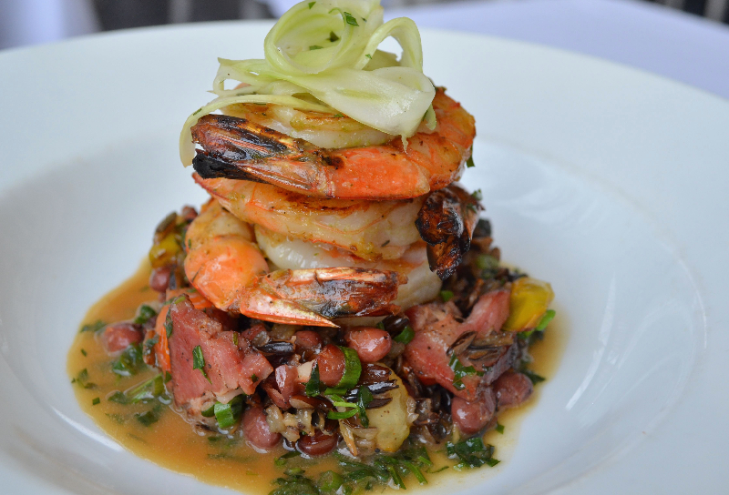 Grilled Wild Gulf Shrimp,  Wild Rice, Red Beans, House Smoked Tasso Ham,  Herbsaint Lobster Broth