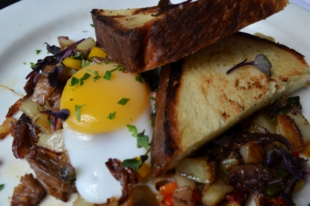 Duck Confit and Truffle Hash, Peppers and Onions, Sunnyside Duck Egg, Brioche Toast